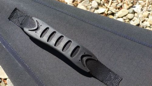Molded rubber carrying handles