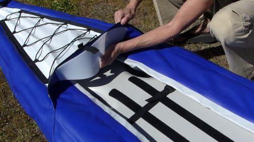 Installing the spray shield insert.