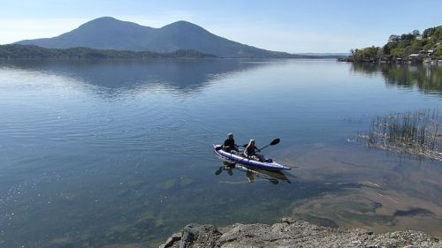 AquaGlide Chelan HB Tandem XL Inflatable Kayak paddled by two.