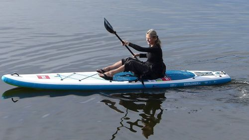 "Paddling as a ""sit on top"" with kayak paddle."