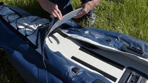 Installing the spray deck visor.