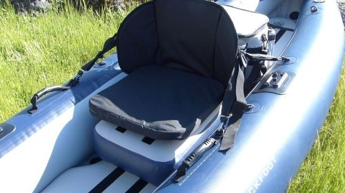 Core seat with booster cushion.