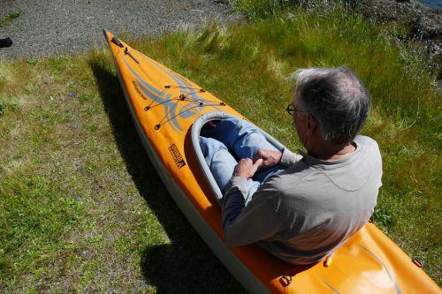 Taller paddler sitting in the EVO