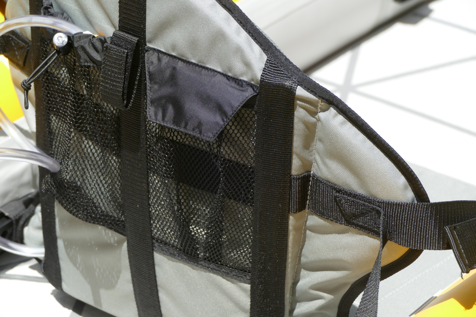Mesh pockets on back of one seat.